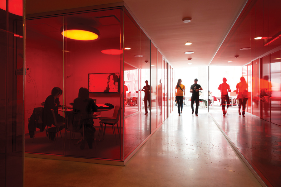 The fifth floor features study rooms encased in translucent red panels