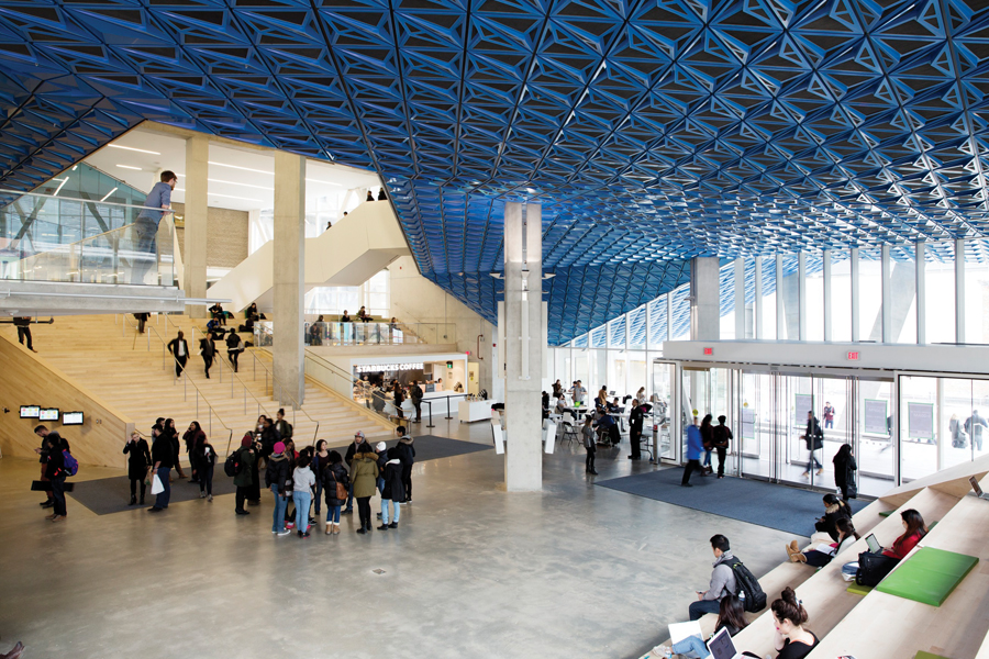 The triple-height atrium is ringed with bleacher-like seating ideal for people-watching with a coffee and a laptop.