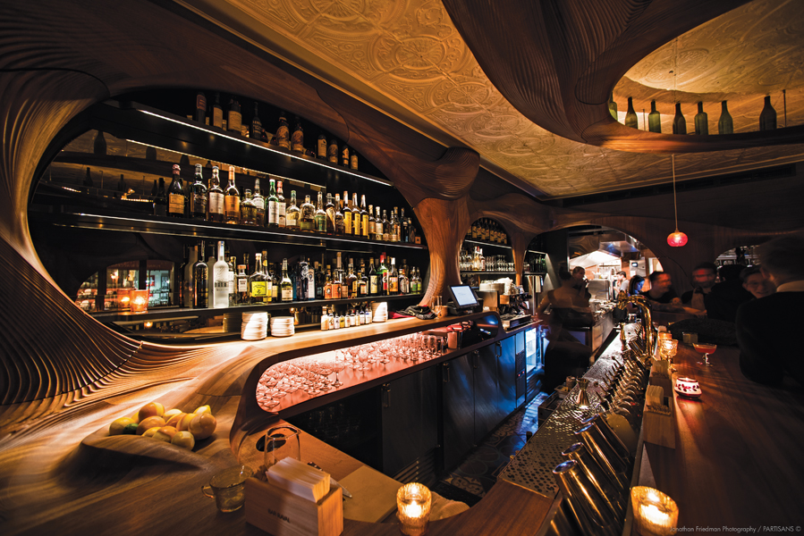 The bar counter includes designated areas for bottles and a generous counter where platters of food can be put on display