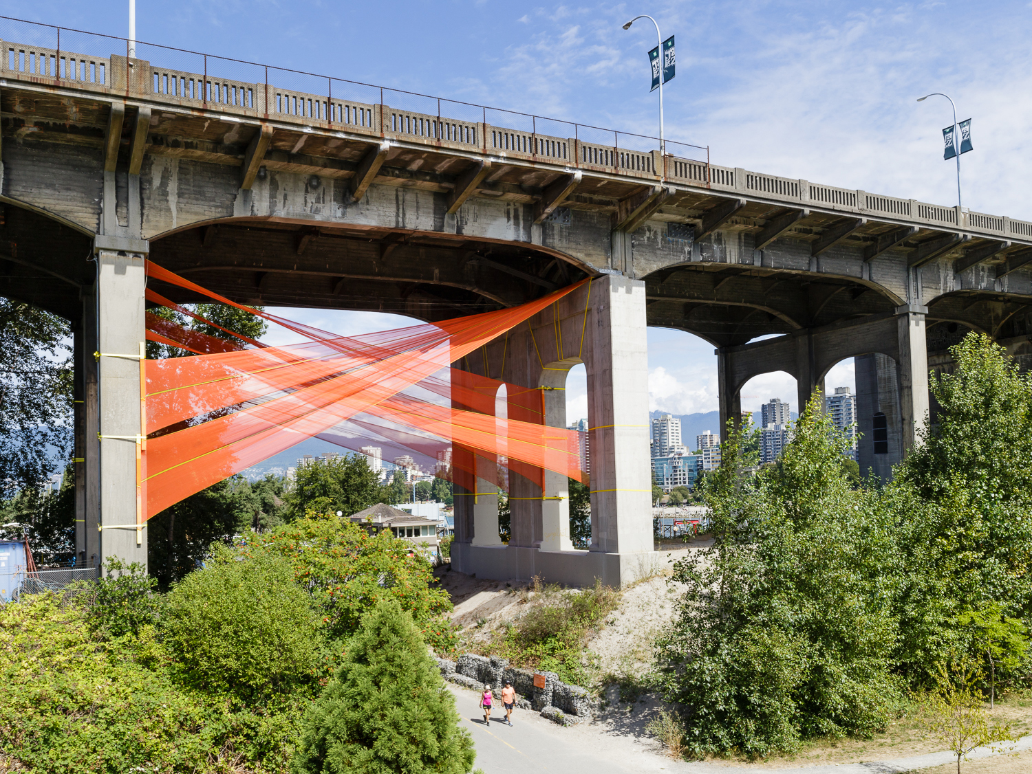 a view of the city fabric installation beneath the burrard street bridge in vancouver