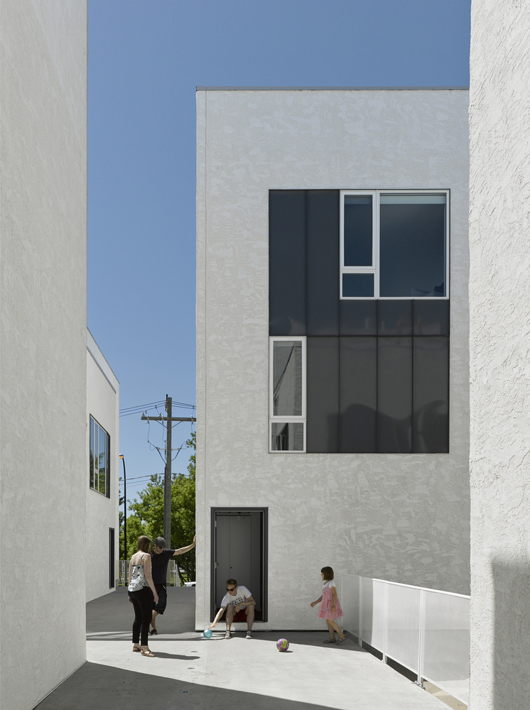 Seeking variation from typical townhouses, You Cube includes an elevated walkway that acts as a semi-public realm.
