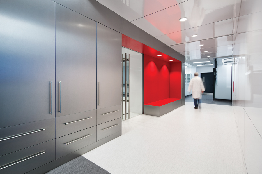 A cherry red alcove adds a bright accent to a hallway in the research centre.