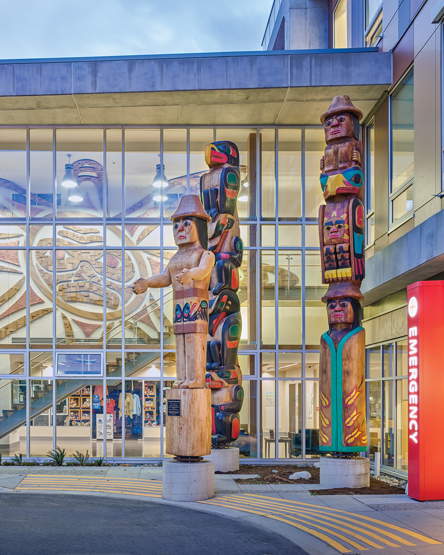Totem poles crafted by local artisans greet patients and visitors at the entrance to the new hospital addition.