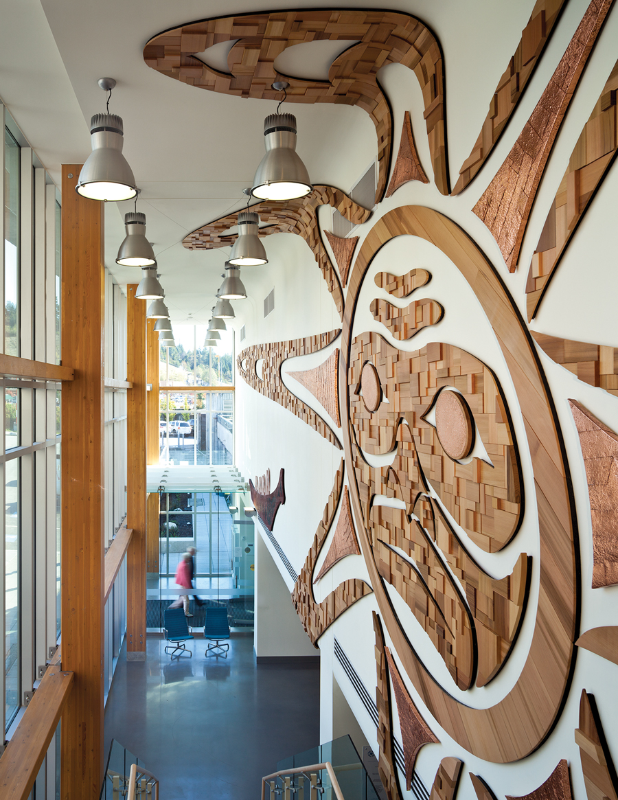 A wood mural in the main lobby references traditional motifs from the local First Nations band.
