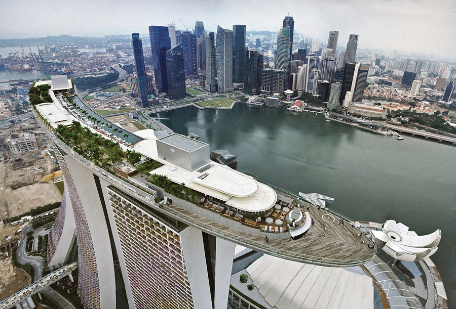 Moshe Safdie's Marina Bay Sands in Singapore includes a sky-high rooftop garden and pool. Photo by Frank Pinckers