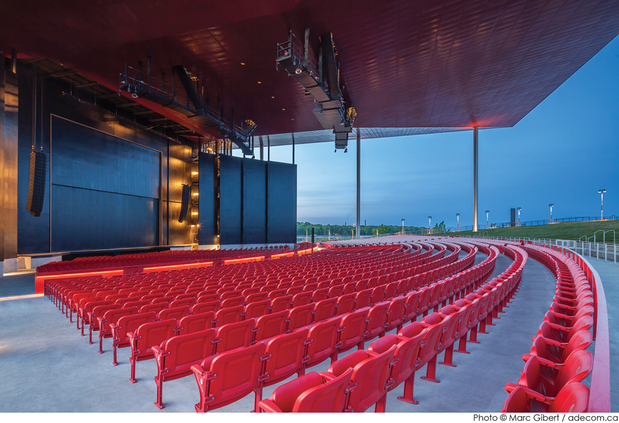 The amphitheatre includes 3,500 fixed seats, with room for spillover audiences on a grassy slope beyond.