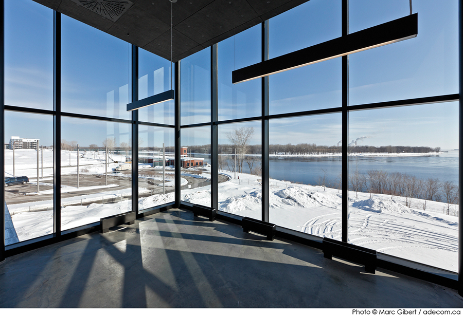 A staff room on the upper level looks out towards the St. Lawrence River.
