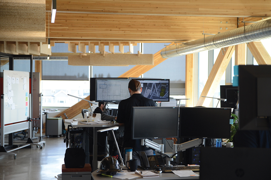 Exposed glulam columns and beams lend a down-to-earth character to the workspaces. (Photo: Ross Auser)