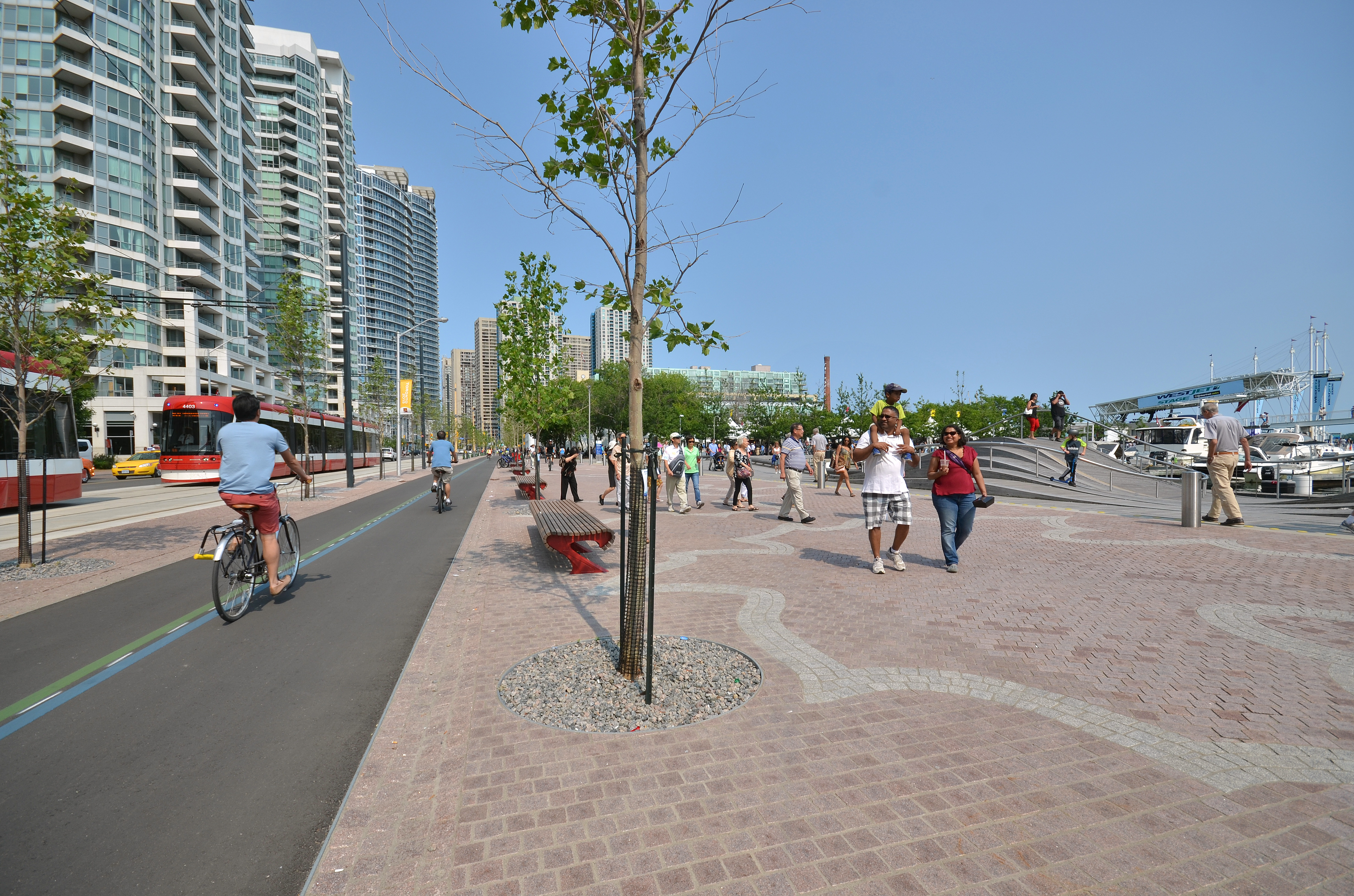 The redesigned Queens Quay, with the WaveDecks visible at right, is a vibrant contribution to Toronto's public realm. Photo: Nicola Betts
