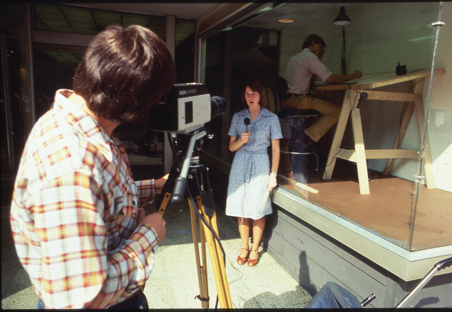 An architect from Moore Grover Harper at work while on display in the window of the Riverdesign Dayton storefront office in 1976. Image: Yale University Library © Centerbrook architects and planners