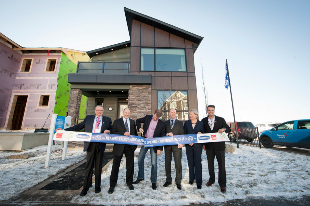 The ribbon is cut on a net-zero energy home in Calgary by Mattamy Homes with Q4 Architects. The home is one of 26 net-zero energy dwellings built as demonstration projects across Canada.