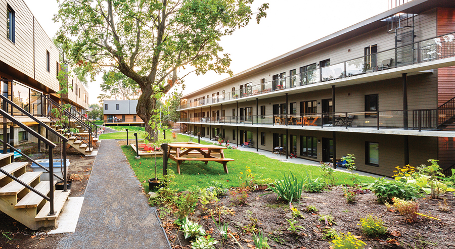 The courtyard includes outdoor eating, play and gardening areas.