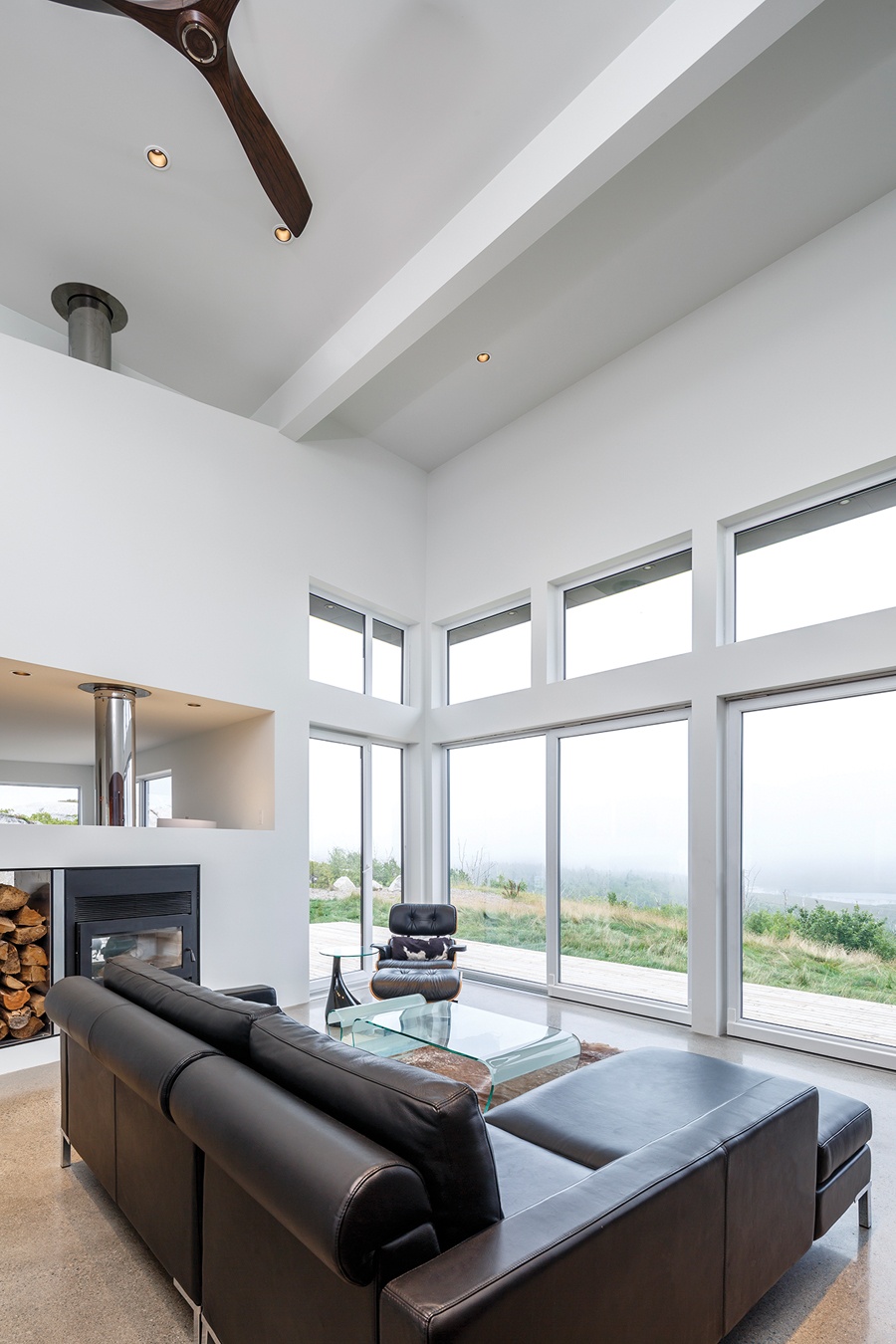 The living room enjoys a panoramic view of an inland lake.