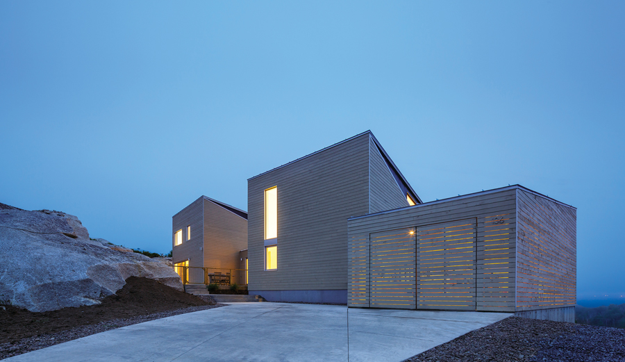 The approach to the house presents a relatively closed façade, in contrast to the expansive lakeside views from within.