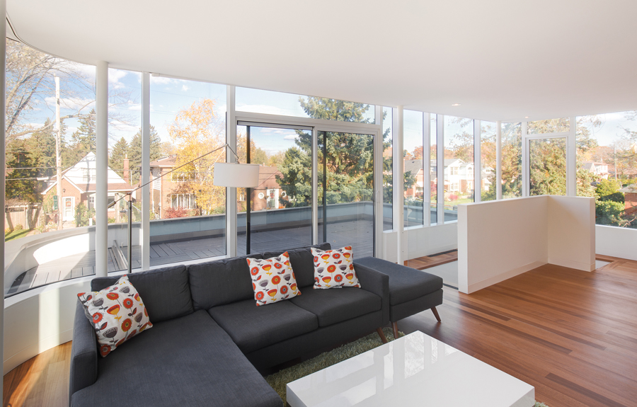 The second floor family room opens onto an outdoor terrace and enjoys treetop views of the surrounding neighbourhood.