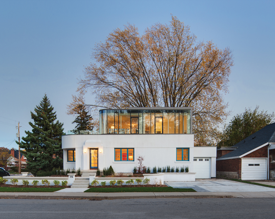 The home's art moderne features were carefully restored, including the smooth exterior finish, cobalt blue window frames, and stylized door surround.