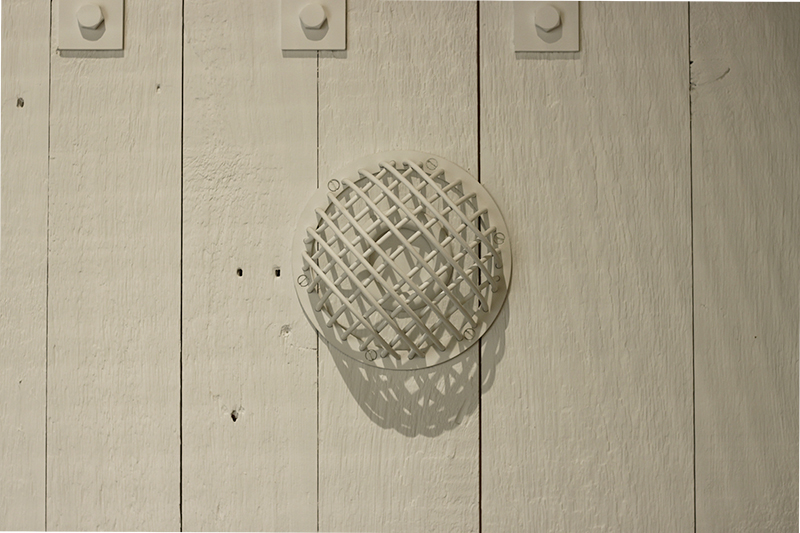 The hemispherical grid protecting the peephole on the inside of the model of a gastight door. Photo by Siobhan Allman.