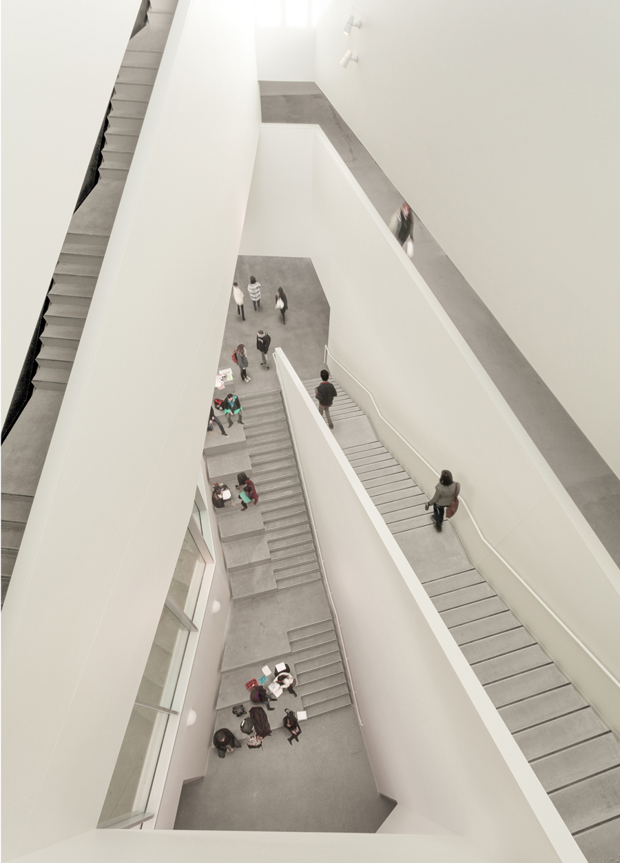 A feature staircase winds around the triangular atrium.