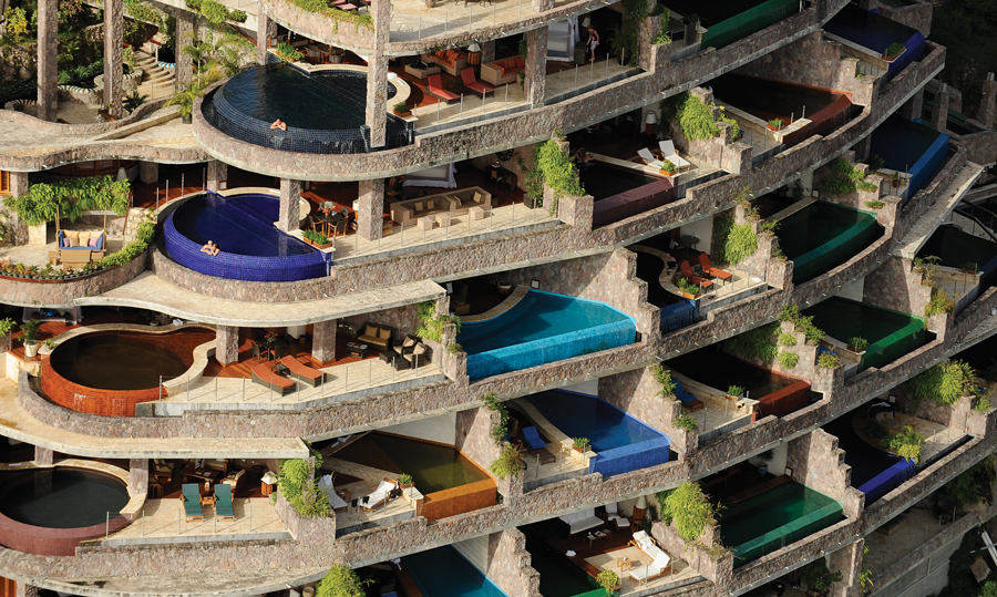 """Taken by helicopter, this photo reveals the layered composition of the resort. The stacked terraces ensure absolute privacy in each of the guest rooms, or """"sanctuaries."""""""