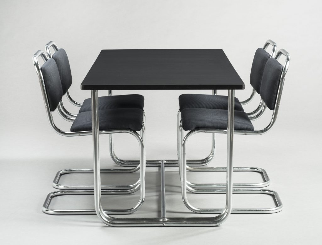 Donald Deskey (1894-1989) Dining Set About 1930 Chromium-plated tubular steel, plastic laminate, upholstery Table: 71.8 x 152.5 x 76.2 cm Chairs: 81.4 x 40.6 x 54.4 cm (each) Produced by Ypsilanti Reed Furniture Company, Ionia, Michigan The Montreal Museum of Fine Arts, Liliane and David M. Stewart Collection, gift of the American Friends of Canada through the generosity of Victoria Barr from the estate of Mr. and Mrs. Alfred H. Barr, Jr. Photo Denis Farley