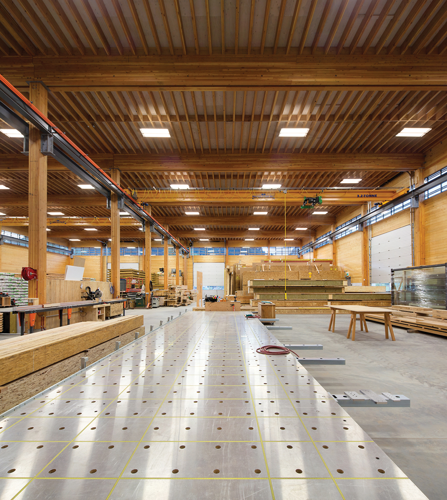 The glulam post-and-beam wood structure is exposed on the interior, as are the CLT wall panels.