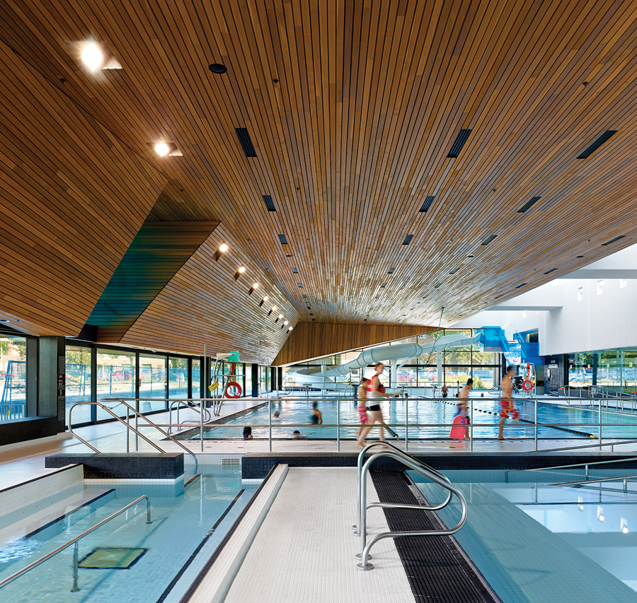 A wood ceiling and line of skylights top the swimming areas.
