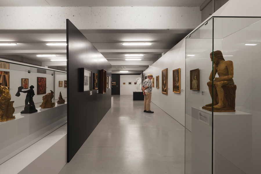 Renovations to the permanent exhibition gallery include new finishes and upgraded mechanical and electrical systems that harmonize with the addition's minimalist aesthetic.