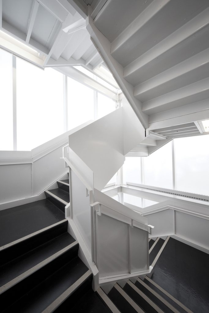 A folded steel-plate stair ascends to an observatory, adding a vertical dimension to the project.