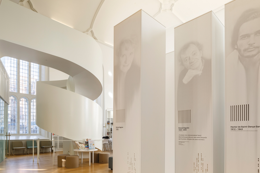 white pillars featuring notable authors are part of an permanent interactive exhibition that weaves through the project, themed around the idea of freedom in Quebec's literature.