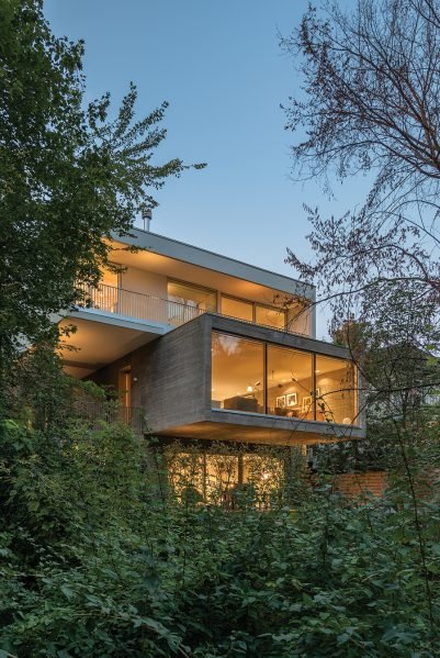 The cantilevered structure of Concrete House responds to the zoning constraints of its ravine-side site in Toronto. Photo by Bob Gundu