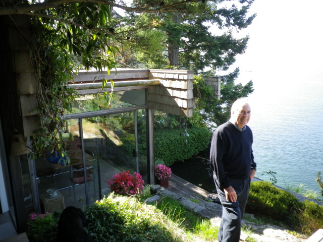 Barry Downs in front of one his houses in West Vancouver. Photo by Eve Lazarus