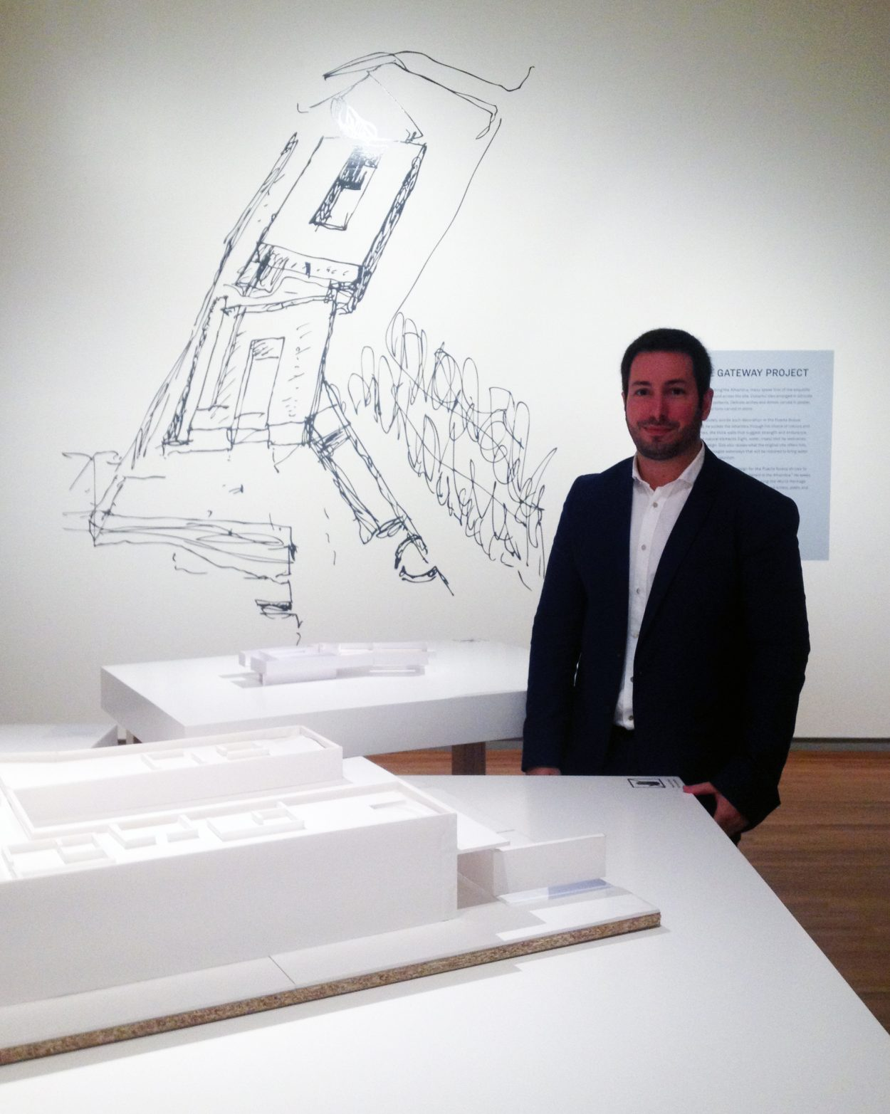 Curator António Choupina alongside a sectional model of the Alhambra visitors' centre created for the exhibition.