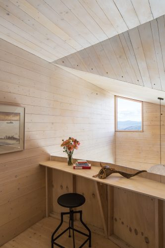 Cross-laminated timber panels give a warm interior finish to a 79-square-metre cabin in Washington State. Photo by The Morrisons