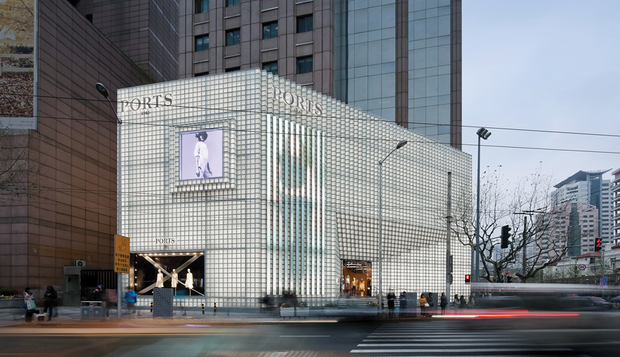 Satin glass blocks embedded with LEDs are arrayed in a 3-D composition to create an icy façade for the Ports 1961 flagship store in Shanghai. Photo by Shengliang Shu