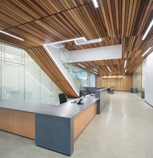 The wood-lined lobby acts as an informal gathering space; its sidewalls include built-in display areas.