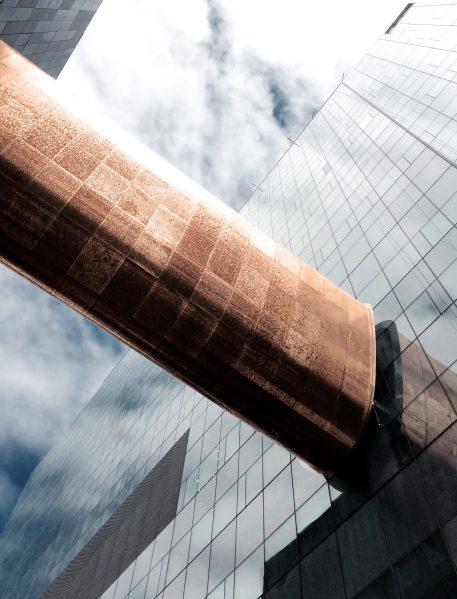 Copper-clad skybridge over Sanguinet Street Photo credit: CannonDesign + NEUF architect(e)s