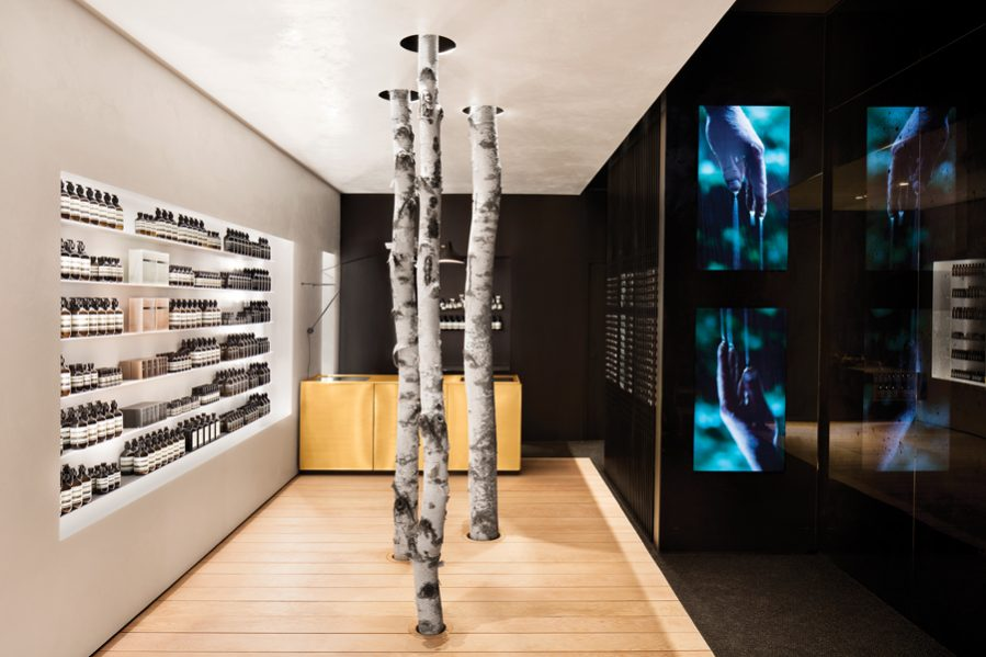 Conceived around the theme of water, Aesop's Westmount store includes a liquid-inspired video installation by artist Pascal Grandmaison. Bespoke touches such as birch trunks and a dock-like wooden floor evoke a lakeside setting.