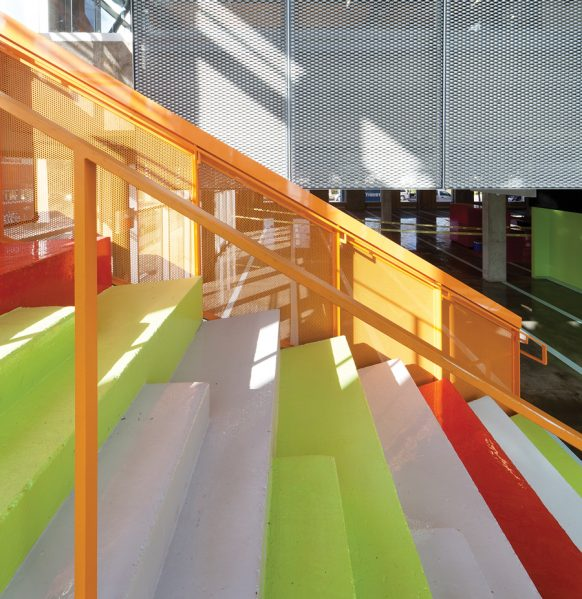 Conceived as an indoor reading garden, a colourful staircase joins the first floor children's library to the upper floor adult section. Photo: STEVE MONTPETIT