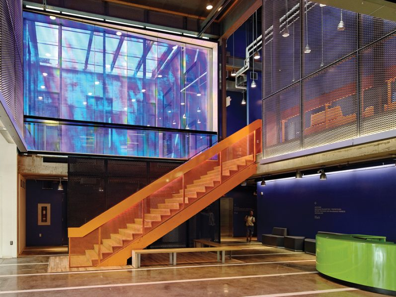 Made from dichroic glass, an art installation by Hal Ingberg brings a rainbow of iridescent tones to the main entry area. The piece adjoins an upper terrace, which acts as spillover space for the second floor theatre lobby.