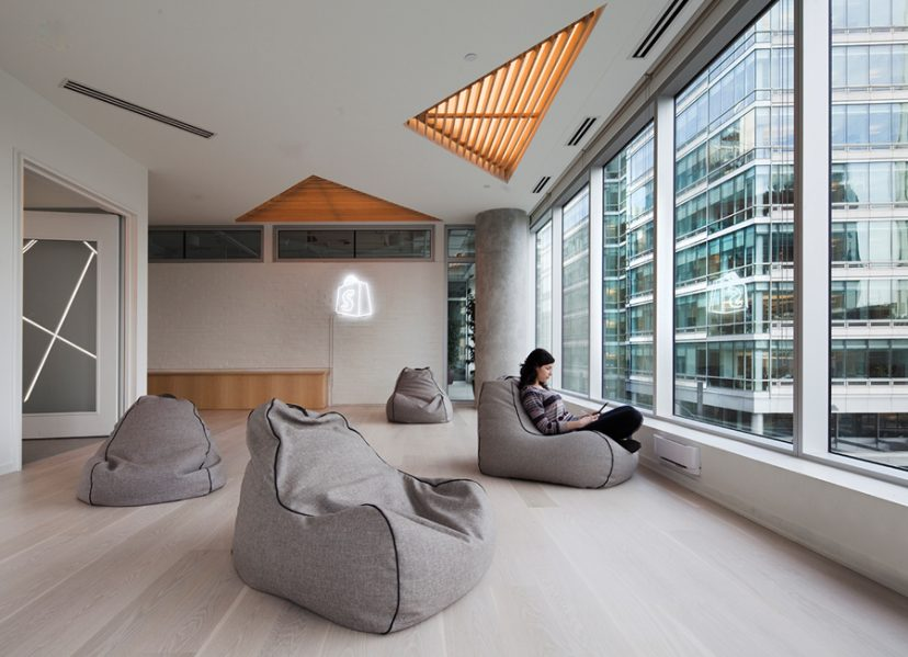 To the southeast of the common area, a work room equipped with bean-bag chairs looks out onto downtown Montreal. Photo by Claude-Simon Langlois