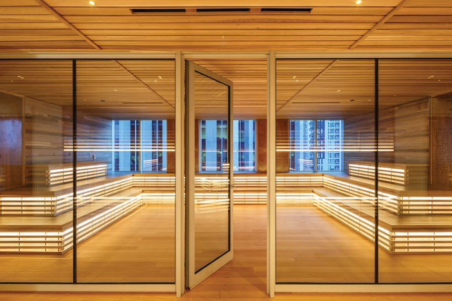 A wood-lined meeting space with tiered seating conveys the relaxed feel of a giant sauna. Photo by Doublespace Photography