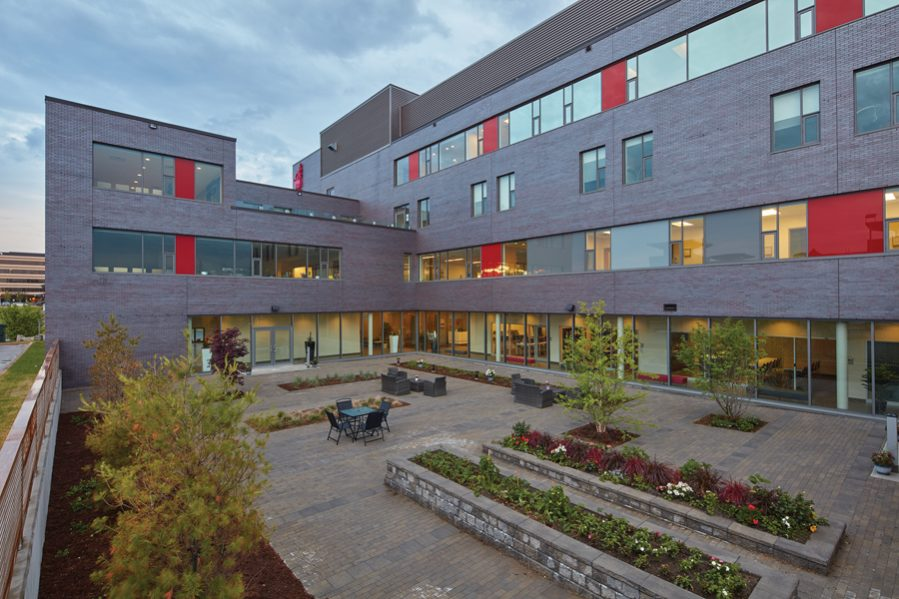 The landscaped courtyard offers a space to connect with nature, and adds to the building's open and welcoming character. In a post-occupancysurvey, 97 per cent of staff agreed that the building promoted a positive atmosphere for seniors that made it easier to inter act with them. Photo by Shai Gil