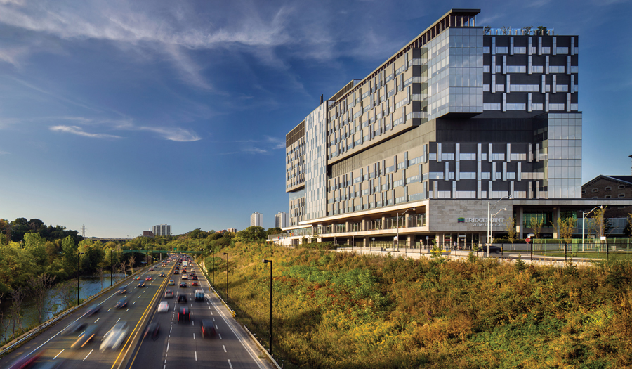 The new hospital building sits higher than its predecessor, offering sweeping views over the Don Valley. Photo by Nic Lehoux