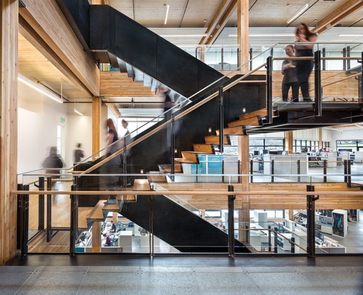 The interior uses a heavy timber structure and includes a feature stair that links between workgroups. Photo by Ed White Photographics