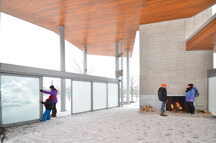 Sliding doors can be pulled close to block wind and snow. A fireplace allows the pavilion to act as a cozy shelter in the winter months and on cool evenings in the shoulder seasons.