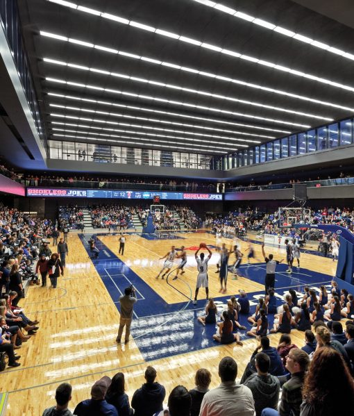 The competition-sized court is housed underground where the floorplate could extend fully to the lot lines, allowing for bleachers on all sides. Tall clerestories provide additional opportunities to see games from the adjacent walkways.