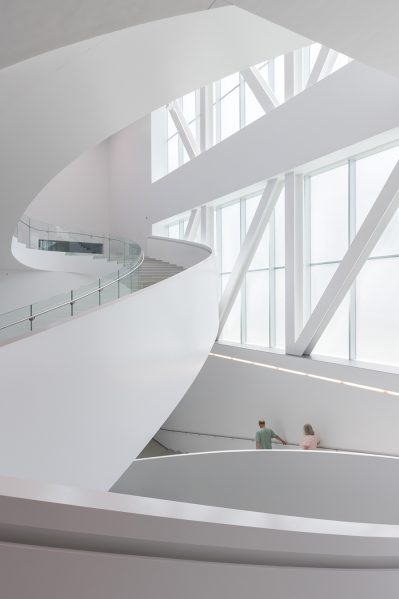 A sculptural stair connects the lower three levels. Photo by Iwan Baan