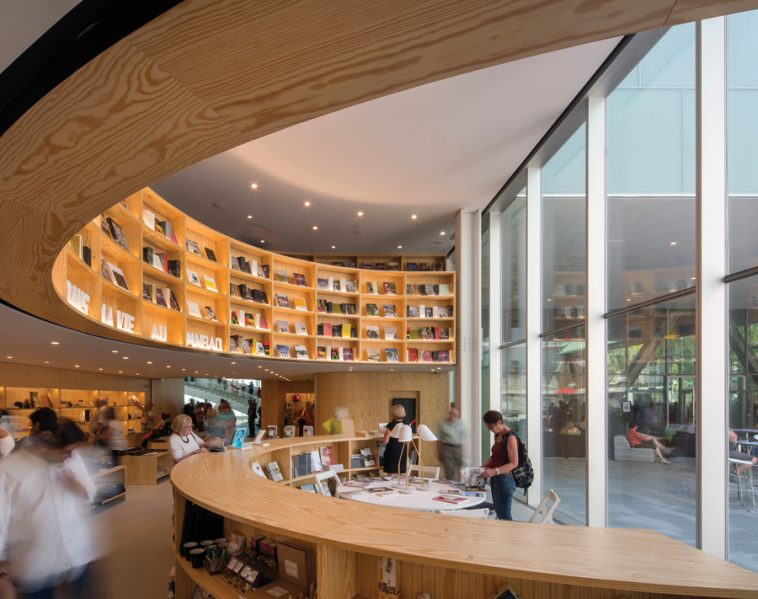 A wood-clad bookstore faces a courtyard framed by the presbytery and former convent buildings. Photo by Nic Lehoux
