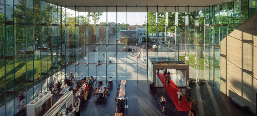 The Grand Hall is detailed as an extension of the outdoor plaza. Photo by Nic Lehoux