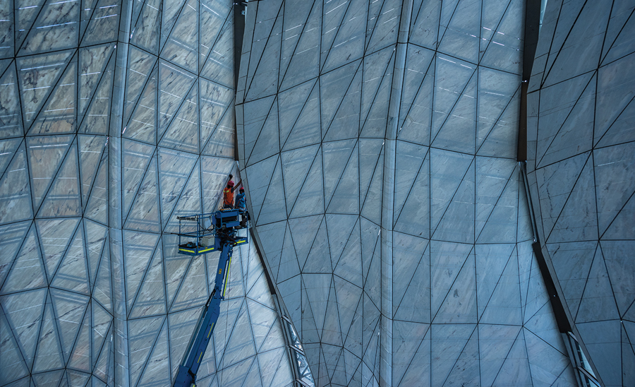 The materiality and faceted geometry of the temple's interior and exterior skins captures the diverse qualities of natural daylight in Chile's capital city. Photo: Guy Wenborne